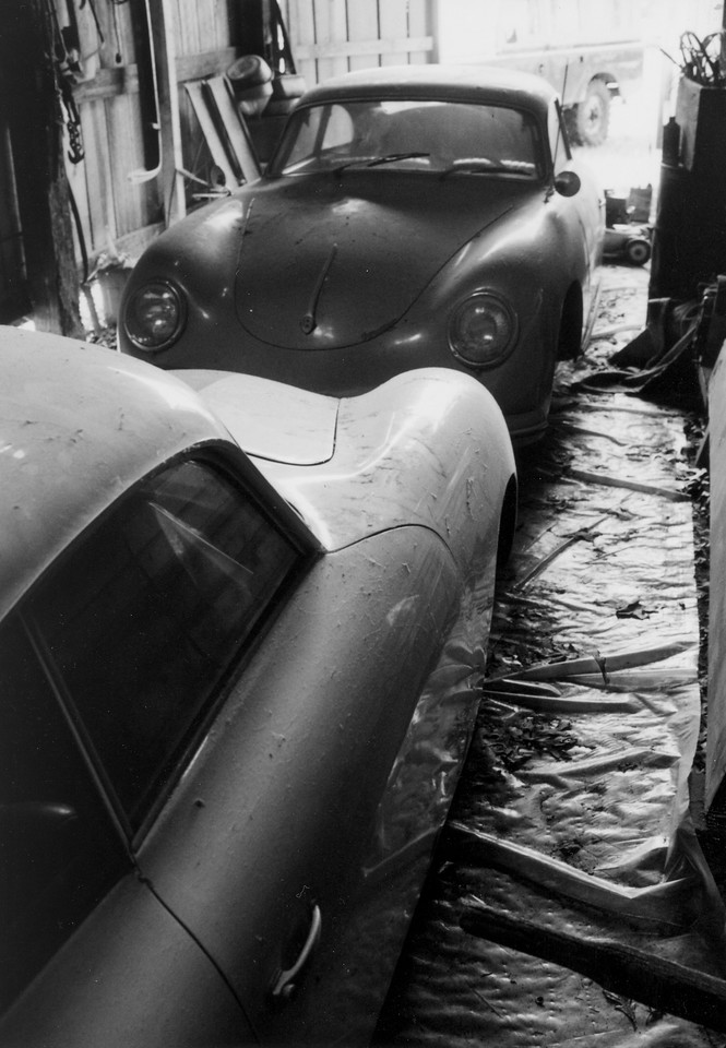 "A real ""Porsches in the Barn"" picture. I had a 24' x 33' barn at my first house - one side was full of Porsches - the other side had a pair of old Land Rovers. The Jeffries car is in the foreground and my 1956 sunroof coupe is just inside the door. At one point I was storing a friend's 1966 Lamborghini 350GT in the barn too."