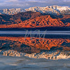 This photo was shot at Badwater in Death Valley National Park in December of 2010.  The salt flats were submerged under about 6 inches of water and made for a spectacular reflection pool in the morning sun light.  I have never seen the salt flats submerged.  I waded about a mile out in the water to set up for this shot.