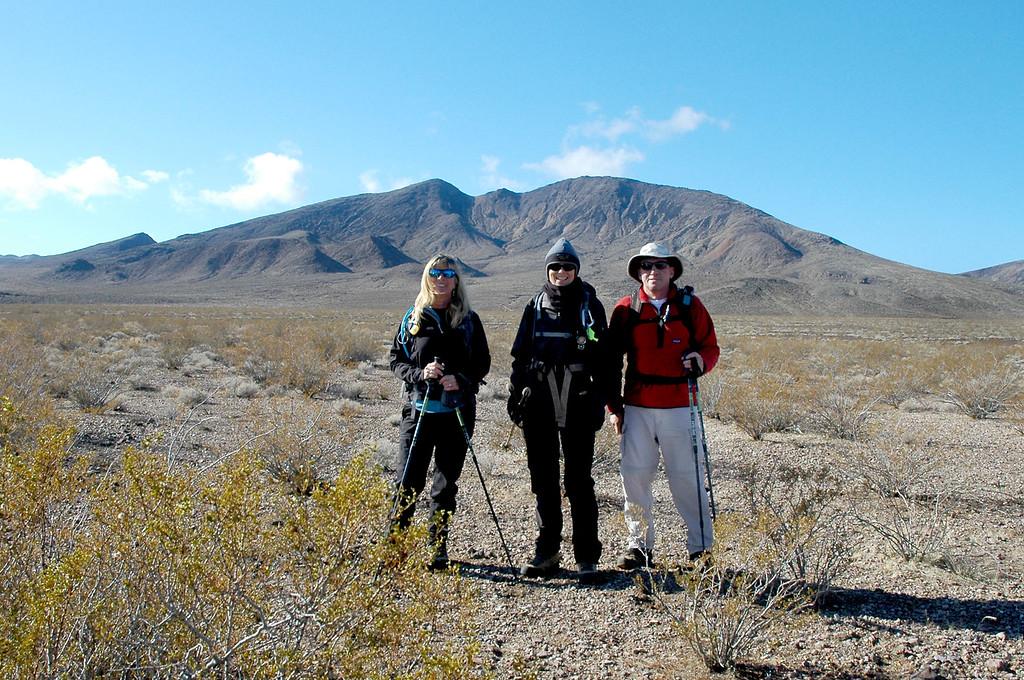 Sooz, Robin and me, Joe ready to start the hike. Calico Peak is the one above Robin's head.