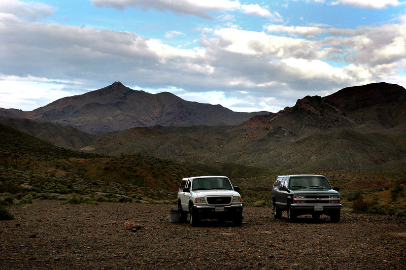 The next morning I woke up to find Bruce's truck parked next to mine. It was windy, but the weather looked like it would be great for hiking. Corkscrew Peak in the background.
