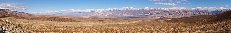 """Panamint Valley from the south with the Cottonwood Range, the Panamint Range on the sky line.  Death Valley National Park January 26, 2008  <a href=""""http://dbdimages.smugmug.com/photos/252964951_ahT5F-O.jpg""""TARGET=""""blank"""">View at 4200x600</a> Use your browser's zoom function as necessary.  This image is available for purchase as a 18307x2315 pixel original sized <a href=""""http://www.smugmug.com/prints/digital-downloads"""">digital download</a> or as a <a href=""""http://dbdimages.smugmug.com/gallery/1904456"""">cropped panoramic print</a>."""
