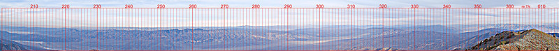 The Western View from Telescope Peak <br /> At sunrise with contrast enhancement<br /> Nov. 5, 2006<br /> <br /> This is a narrow cut along the northwest horizon from 200 degrees true clockwise to 10 degrees. Bearing markings have been added. Look for your favorite peaks! How many can you find?<br /> A partial list is as follows:<br /> Pleasant View Ridge, Waterman Mountain, Pacifico Mountain, Mount Gleason, Government Peak, Almond Mountain, Red Mountain, Dome Mountain, Searles Lake, Point North Slate, El Paso Mountains, Black Mountain, Argus Peak, Middle Knob, Double Mountain, Cummings Mountain, Point8740, Bear Mountain, Big Pine Mountain, Piute Peak, Owens Peak, Sawtooth Peak, Bartolas Country, Parrot Point, Parkinson Peak, Maturango Peak, Sherman Peak, Lookout Peak, Silver Peak, Smith Mountain, Round Mountain, Coso Peak, Point7450, Olancha Peak, Kern Peak, Vandever Mountain, Florence Peak, Rainbow Mountain, Needham Mountain, Lookout Mountain, Mush Mountain, Trail Peak, Mount Kaweah, Cirque Peak, Joe Devil Peak, Mount Chamberlin, Mount Langley, Mount Corcoran, Mount Whitney, Mount Russell, Mount Williamson, Mount Tyndall, Mount Keith, Mount Bradley, University Peak, Black Mountain, Cerro Gordo Peak, New York Peak, Mount Goddard, Mount Pinchot, Keynot Peak, Mount Inyo, Split Mountain, North Palisade, Mount Sill, Lake Hill, Galena Peak, Mount Tom, Jackass Peak, Waucoba Mountain, Point3341m, Squaw Peak, Hunter Mountain, Panamint Butte, Piute Mountain, Mount Barcroft, Mount Nunn, White Mountain, Dry Mountain, Pinto Peak, White Top Mountain, Point8261, Last Chance Mountain, Tin Mountain, Point6250, Magruder Mountain, Point633, Point8460, Tucki Mountain, Bennett Peak, Grapevine Peak, Wahguyhe Peak, Stonewall Mountain, Rogers Peak, Thimble Peak, Wildrose Peak, Corkscrew Peak, Point6136, Point6056, Tolicha Peak, Point6075, Point5064, Sawtooth Mountain, and also Owens Lake, Searles Lake, Panamint Dunes<br /> <br /> This image was shot from 36deg 10.191'N 117deg 05.362'W<br