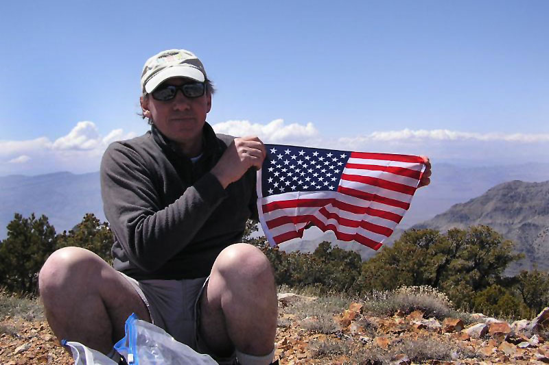 Me with a US flag that was in the peak register box.<br /> <br /> Photo by Sooz