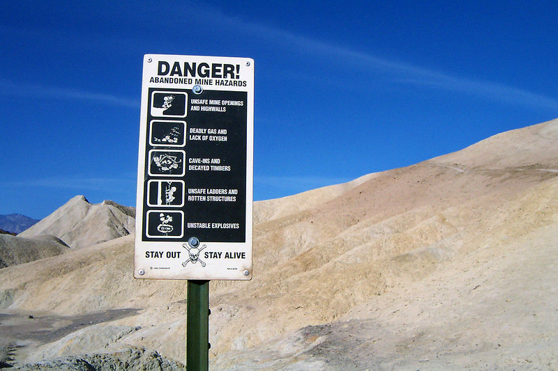A sign warning about the dangers of mines. Hope we come across one, I like mines.