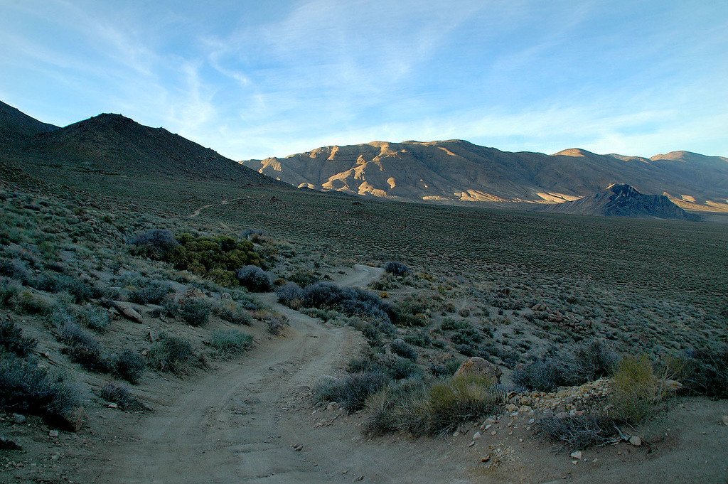 Just finshed the worse section of road which was coming down from the pass. Banged the truck's frame on a rock coming down a steep rocky section. Striped Butte can be seen on the right.