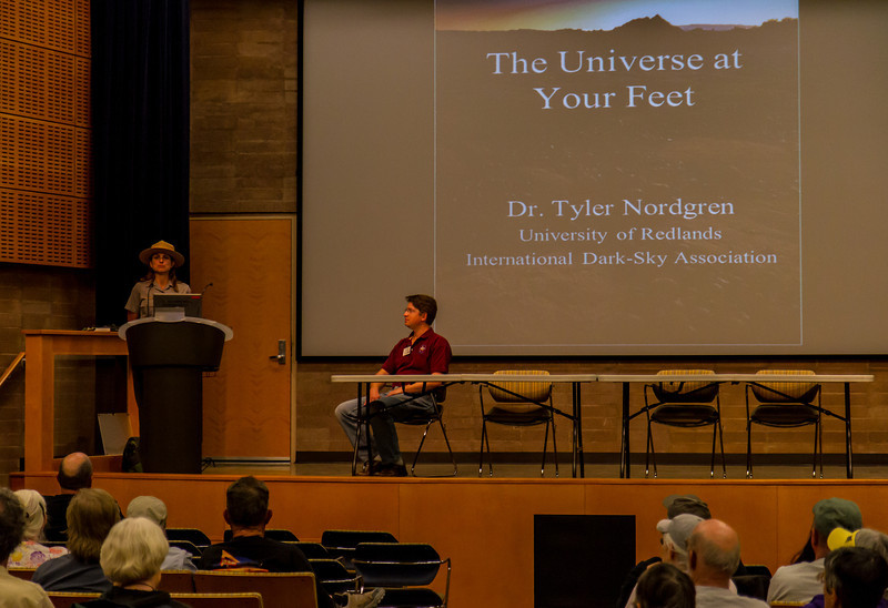 Death Valley National Park Education Specialist Stephanie Kyriazis (left) introduces Dr. Tyler Nordgren (right) – The Universe at Your Feet<br /> A night in the national parks is an opportunity to sleep under the stars and see the sky the way every generation of human beings once did. But astronomy in the parks doesn't end when the sun comes up. The national parks are also a window to the other worlds of our solar system. A hike through the red rocks of Utah, or the geysers of Yellowstone is to experience the sands of Mars and ice volcanoes on a moon of Saturn. In America's national parks, come for the landscape, stay for the Universe.