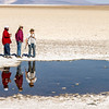 Field trip to Mars analog site of Badwater with Dr. Susanne Douglas, (right).<br /> <br /> Many areas of Death Valley have groundwater springs which rise at the edges of the salt pan. The resulting salts which form are called evaporites and these evaporites are inhabited by a variety of different microbial communities. Within these evaporites, the communities find protection from harsh light and fluctuating water levels and, in turn, affect the mineralogy of the salts they inhabit. These mineral-dwelling microbial communities are analogues for possible life forms in the evaporites of Mars, and are being studied in order to define what needs life has in an evaporate environment. We will be touring a number of pools at Badwater. These pools are within hundreds of meters of each other yet have differing chemical compositions. We will see different types of microbial communities in these pools and the minerals they produce. If you have a magnifying glass, you may wish to bring it. We will be traversing some rough, but flat ground and handling samples that will dry your hands.