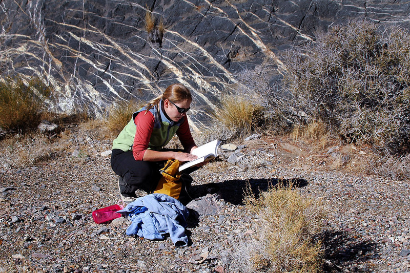 Rebecca checking the guide book trying to figure out where the fossils are located.