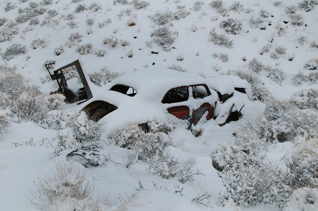 The old Studebaker covered in snow.
