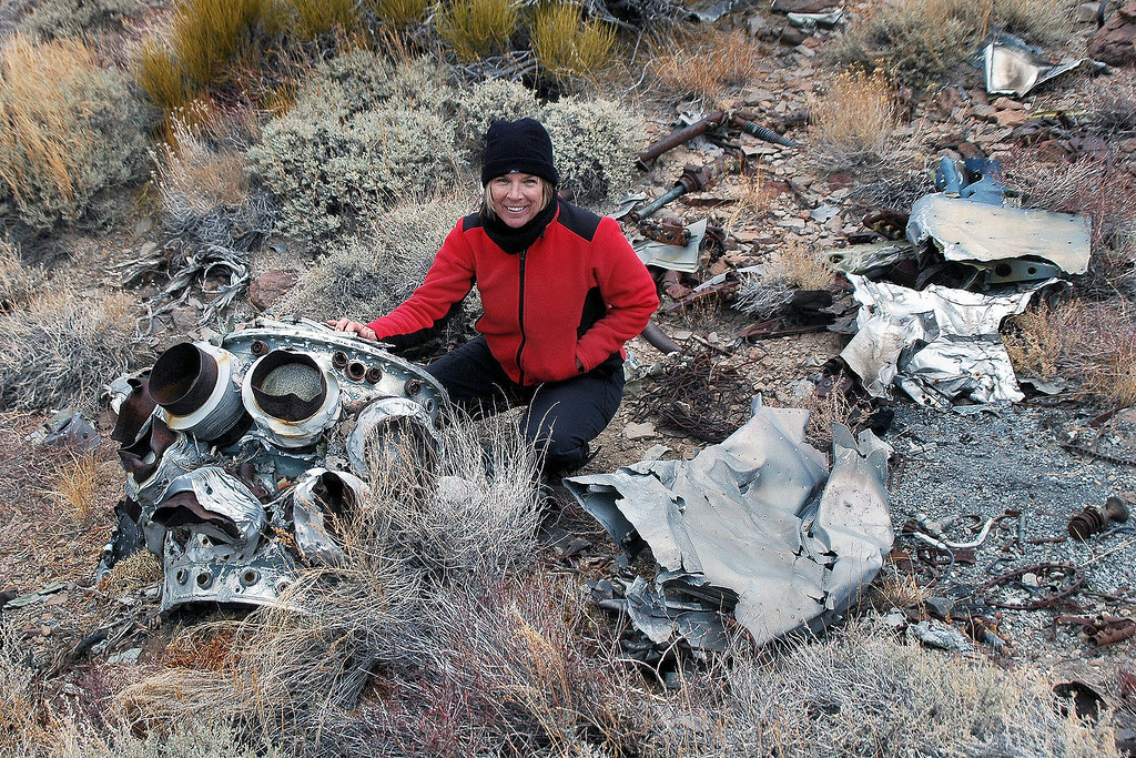 "Sooz with the remains of the Pratt-Whitney R-2800-10W ""Double Wasp"" 18-cylinder radial that powered the F6F-5 Hellcat that crashed here on 9/2/45."