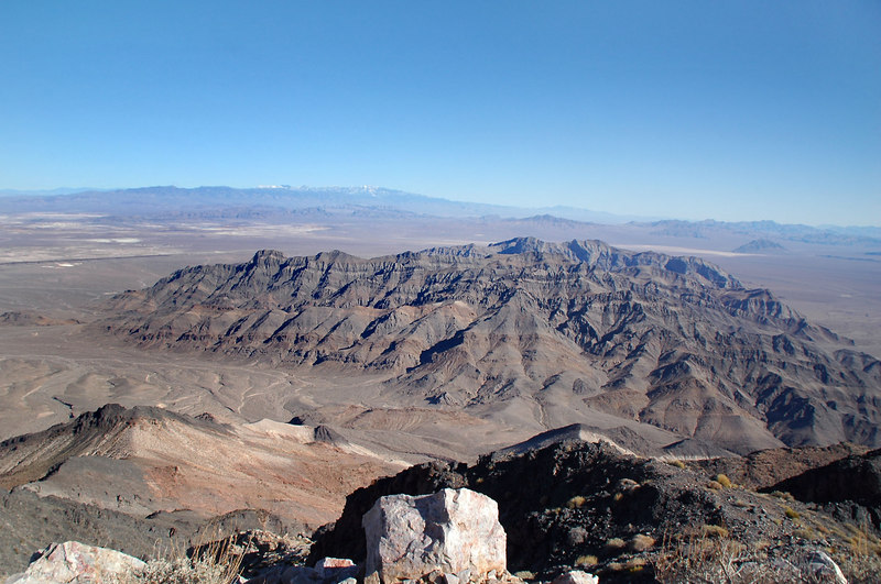 Looking southeast at the south end of the Funeral Mountains of which Pyramid Peak is in. The mountains in this shot are in the Funeral Mountains Wildrness which is outside Death Valley Nat'l Park. In the distance are the snow capped Spring Mountains in Nevada.