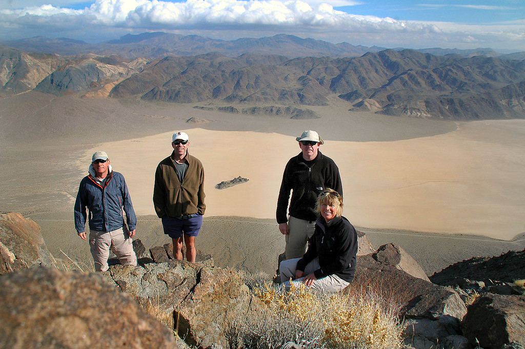 Me, Ken, John and Sooz on top of Ubehebe Peak with the north end of the Racetrack.