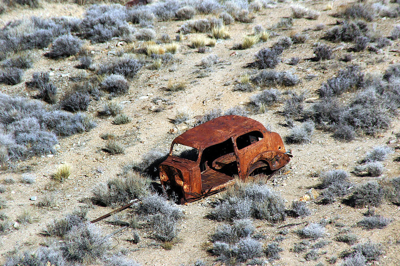 Another rusty car.
