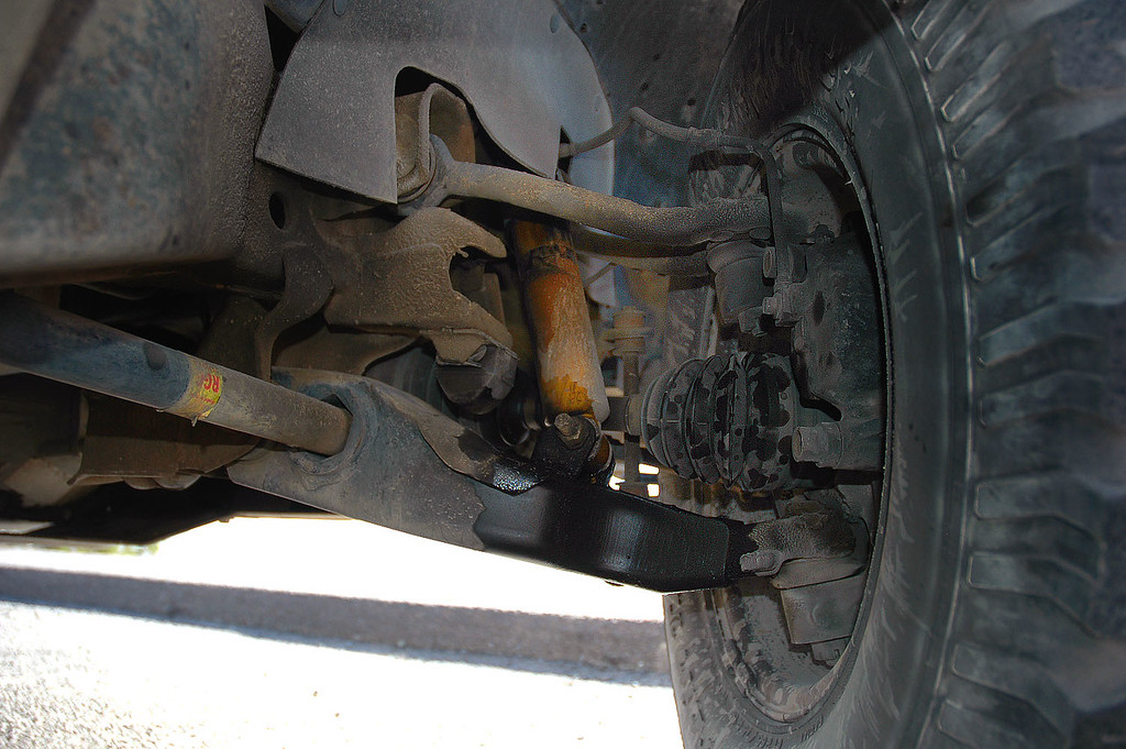 When I got out of the truck, I smelled oil. Looking under the truck found that the right front shock blew out it's seals. I never did like washbroad roads, time for some new shocks.
