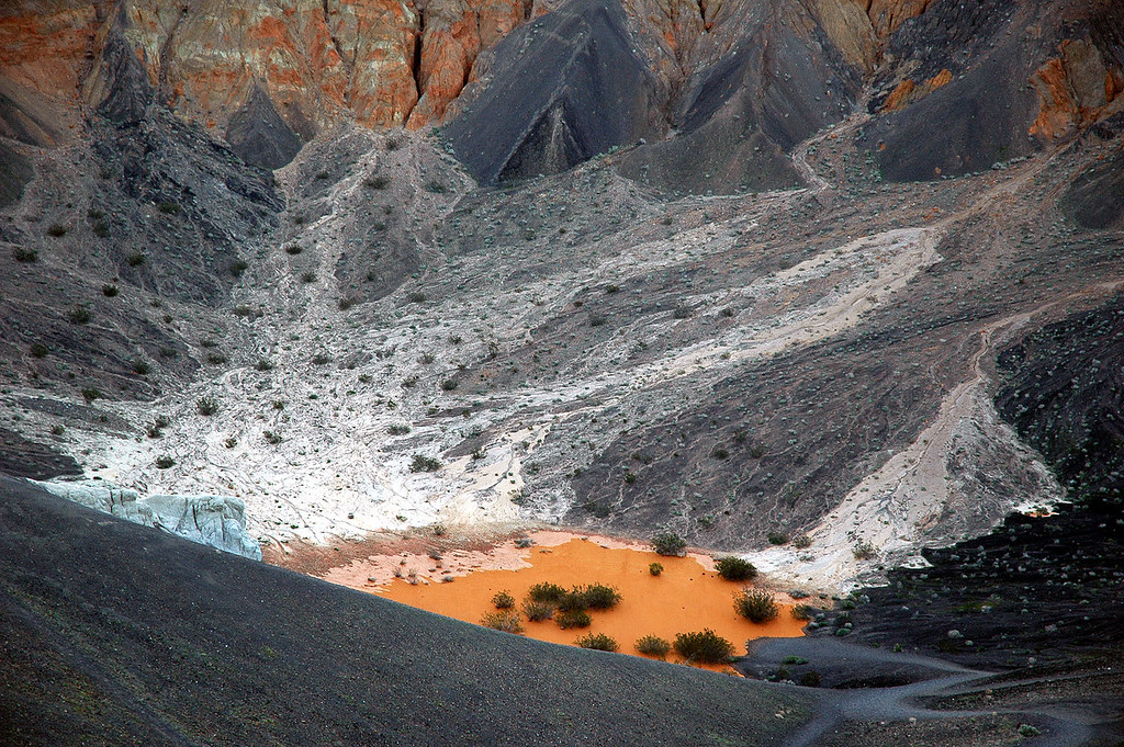 Zoomed in on the colorful pool at the bottom of the crater.