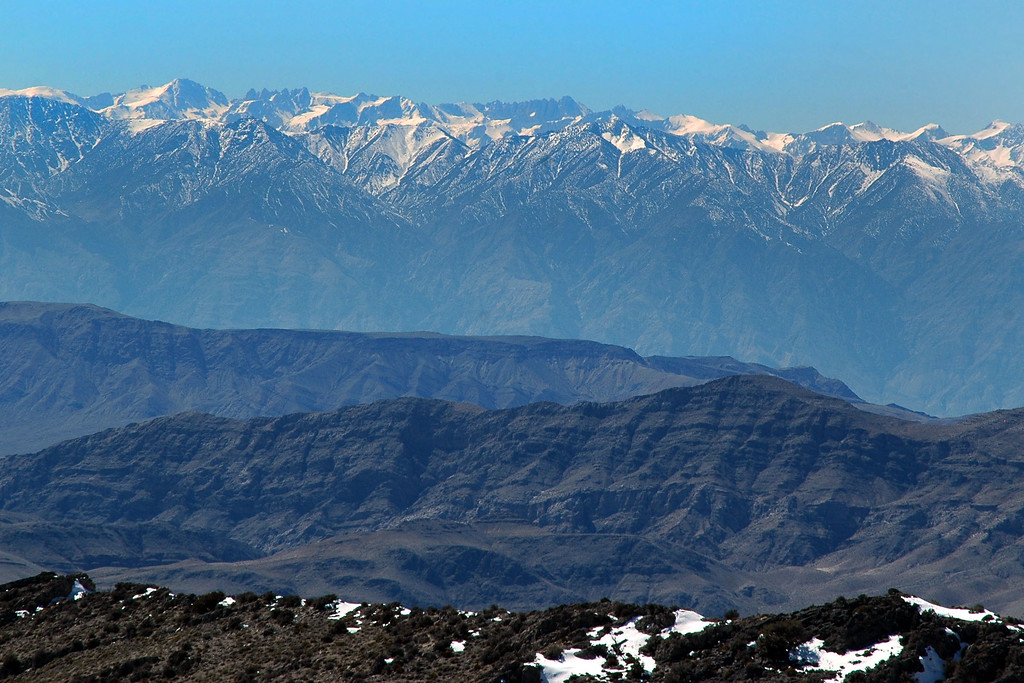 Mount Whitney's peak about 50 miles away behind the Inyo Mts, it was a very clear day. This was taken with a lot of zoom.