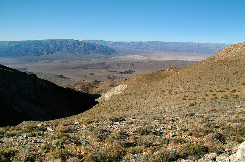 The next morning we went exploring on the dirt roads and ended up on a peak with a view. This is looking southwest to the Stovepipe Wells area. It was windy and cold up here.