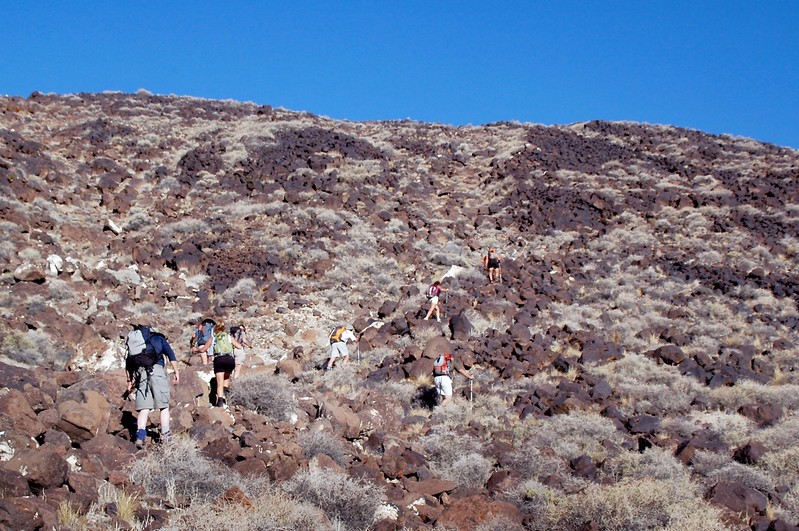 The hike starts off with a 800 foot climb on a lava covered slope to reach the ridge that we will follow to the peak.