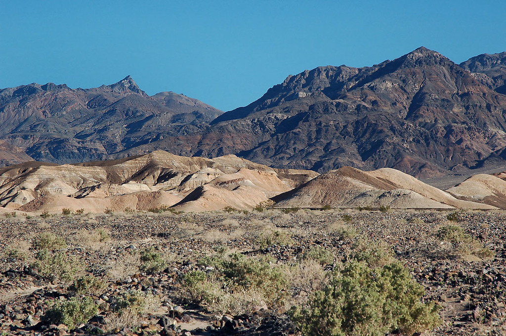 The Kit Fox Hills with a section of the Grapevine Mountains behind them.