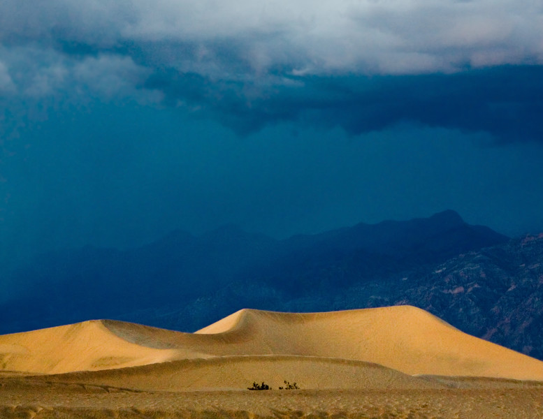 A rare rain storm approaches the Mesquite Flat sand dunes at Death Valley National Park.