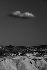 Cloud over Death Valley badlands