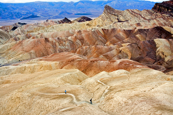 Hiking along the colorful clay and mudstone badlands of Death Valley National Park.