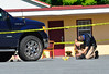 Det. Sgt. Greg Eaton, of the Brattleboro Police Department, films the location and objects where the evidence markers were placed during a suspicious death investigation at the EconoLodge, on Canal Street in Brattleboro, Vt., on Friday, July 31, 2020. Kristopher Radder, Brattleboro Reformer via AP