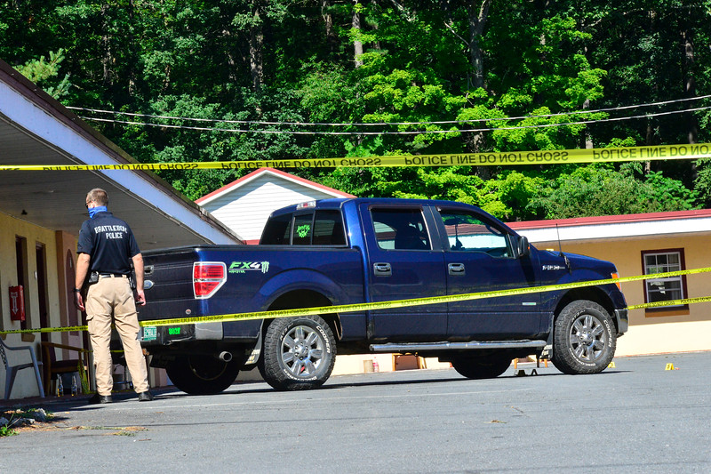 Brattleboro Police Department investigates a suspicions death that happened around 5:45 a.m. at the EconoLodge, on Canal Street in Brattleboro, Vt., on Friday, July 31, 2020. Kristopher Radder, Brattleboro Reformer via AP