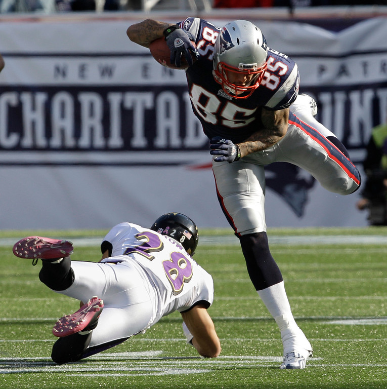 . New England Patriots tight end Aaron Hernandez (85)n leaps over Baltimore Ravens safety Tom Zbikowski (28) during third quarter action of their NFL football game in Foxborough, Mass., Sunday afternoon, Oct. 17, 2010. The Patriots defeated the Ravens 23-20.  (AP Photo/Stephan Savoia)
