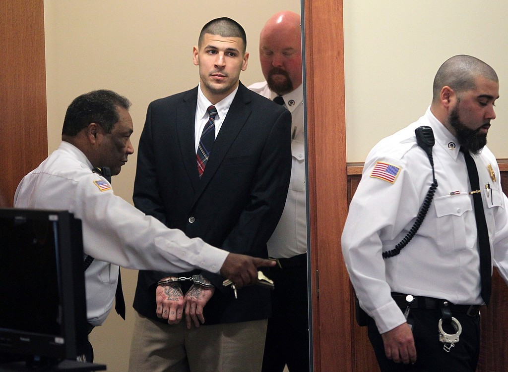 . FILE - In this Monday, Dec. 23, 2013, file photo, former New England Patriots NFL football player Aaron Hernandez is led into his court appearance at the Fall River Superior Court in Fall River, Mass. Massachusetts prison officials said Hernandez hanged himself in his cell and was pronounced dead at a hospital early Wednesday, April 19, 2017. (Matt Stone/The Boston Herald via AP, Pool, File)