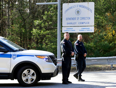 . Police guard the entrance of the Souza-Baranowski Correctional Center, Wednesday, April 19, 2017, in Shirley, Mass. Former NFL star Aaron Hernandez, who was serving a life sentence for a murder conviction and just days ago was acquitted of a double murder, died after hanging himself at the prison cell early Wednesday, Massachusetts prisons officials said. (AP Photo/Elise Amendola)