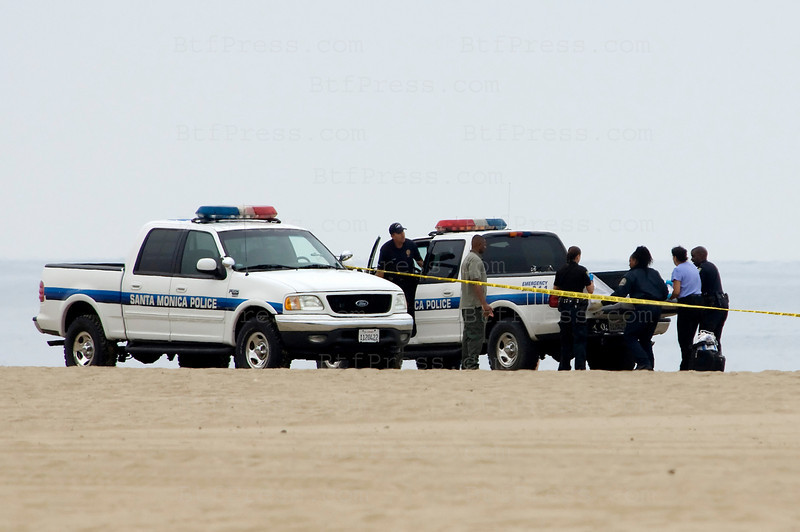 "Exclusive. One man was found dead on Santa Monica beach, suicide or crime, the police find a hand gun on the sand. Santa Monica beach was used for filming the TV Serie ""Baywatch"""