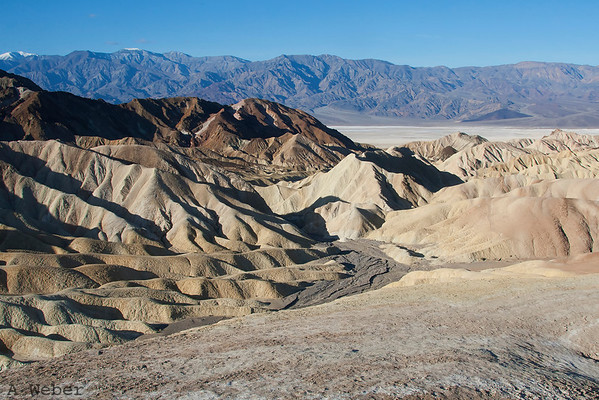 View from the Zabriskie Point in the Death Valley National Park = snow capped Telescope Peak in the background