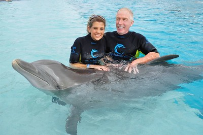 Debbie and Tom with dolphin in Bahamas