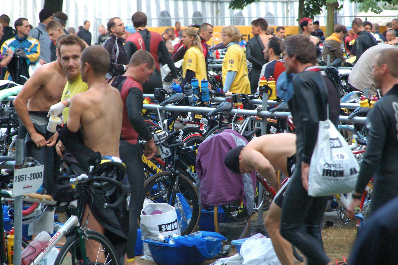 Ironman Germany 2004   Rick's bike is the one with the red stripe in the middle # 1859[#Beginning of Shooting Data Section]<br /> Nikon D70<br /> Focal Length: 120mm<br /> Optimize Image: Custom<br /> Color Mode: Mode IIIa (sRGB)<br /> Noise Reduction: OFF<br /> 2004/07/11 00:30:02.1<br /> Exposure Mode: Aperture Priority<br /> White Balance: Auto<br /> Tone Comp: User-Defined Custom Curve<br /> RAW (12-bit) Lossless<br /> Metering Mode: Multi-Pattern<br /> AF Mode: AF-S<br /> Hue Adjustment: 0°<br /> Image Size:  Large (3008 x 2000)<br /> 1/80 sec - F/6.3<br /> Flash Sync Mode: Not Attached<br /> Saturation:  Normal<br /> Exposure Comp.: 0 EV<br /> Sharpening: None<br /> Lens: 24-120mm F/3.5-5.6 D<br /> Sensitivity: ISO 640<br /> Image Comment: (c) Mark Slifkin 2004               <br /> [#End of Shooting Data Section]