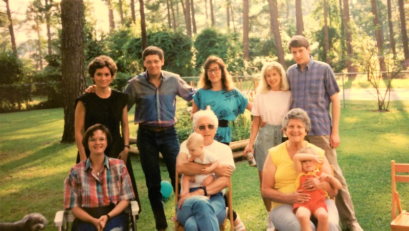 Top Row: Linda, Scott, Jennifer, Debbie & Rick. Bottom Row: Tammy, Cameron on  Alfred Carson's lap and Meryl and Luigia Carson's lap. 109 Northgate Rd Backyard 1989.