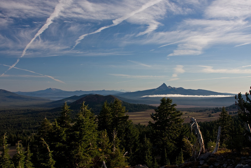 Looking North from the Rim, Mt Thielsen (9182ft) stands with the 3 Sisters barely showing on the horizon.  In the foreground shows Red Cone (7363ft) with Diamond Lake peeking around the corner.