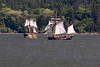 """05-17-09 - Hawaiian Chieftain and Lady Washington were visiting Hood River during their 2009 """"Rediscovering the Columbia River"""" voyage.  We were driving along when we spotted the two ships sailing for each other. The Battle Sails feature a re-creation of an 18th-century naval skirmish with cannon fire (blanks, of course) and close-quarter maneuvers.  <br /> <br /> Thanks for looking -Deb"""