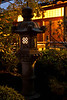 Early Morning at the Japanese Garden<br /> I had taken a photo of this lantern earlier in the year and was drawn back to it.  This time the lights were on in the pavilion lending a warm glow to the photo and created some interesting shadows on the lantern.  <br /> <br /> ~Deb<br /> 10/5/2010