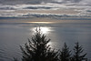 Reflections on the Ocean<br /> <br /> The ocean was so calm that you can see reflections of the clouds.  The picture was taken from the top of Neahkahnie Mountain.  The camera was pointed right into the sun with the polarizer on.<br /> <br /> ~Deb<br /> 2/3/2010