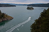 Deception Pass<br /> A boat going through the strait between Fidalgo Island and Whidbey Island.  Mt Baker in the upper left corner<br /> ~Deb<br /> 3/21/10