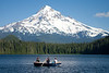 Lost Lake Fishing<br /> I was hoping for the still lake reflection and instead found this tranquil scene of a man rowing the boat while the two women fished. <br /> <br /> Lost Lake is the largest lake in Oregon that doesn't allow motorized boats.  Majestic Mt Hood in the background.  <br /> Ahhhh, July in Oregon.<br /> ~Deb<br /> 7/18/10