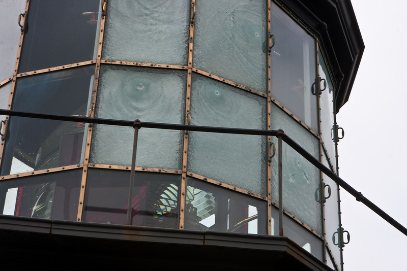 "A sad capture On January 12, two men drove their truck down a blocked maintenance road to Oregon's 120 year old Cape Meares Lighthouse.  For whatever reason, they started shooting at the lighthouse.  Their shots broke 15 windows of the lighthouse and several pieces of the historic fresnel lens.   This photo shows some of the bullet holes and in the lower right, the broken fresnel lens.  The lens was manufactured in Paris.  The company still exists but no longer makes glass for lighthouses.  Cost to repair the lighthouse is estimated over half a million dollars.  Fortunately, there are still a handful of artists who can make a new lens.  Support groups are working to raise funds for the repairs..  An article about the two arrested.  <a href=""http://www.oregonlive.com/news/index.ssf/2010/02/two_arrested_in_shattering_of.html"">Here</a>  ~Deb 5/23/10"