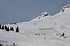 Above Timberline<br /> Mt Hood's Palmer snowfield is a bustle of activity with the snow boarders and skiers (showing up as tiny dots).  The Palmer chairlift was built to withstand wind gusts of over 100 miles per hour (160 km/h) and 200 inches (510 cm) of snow. From the rocks above the chairlift, the snow was blowing against the blue sky...Brrr<br /> <br /> Not a great shot but I liked the patterns in the snow from all the activity.<br /> ~Deb<br /> 3/28/10