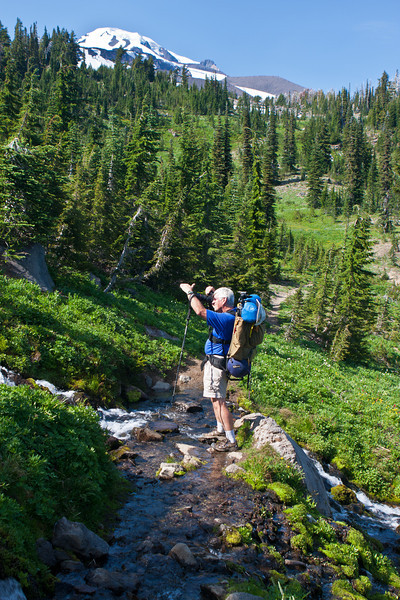 Backpacking in August<br /> I was looking for the photo of a quiet lake in the early morning and wanted to go backpacking once again.  At the last moment, I chose to go back to one of my favorite spots, Mt Adams.  I wasn't disappointed.  It was like seeing an old friend.  Dennis was a great sport about it and never complained once even through all the bugs.  <br /> <br /> It has been confirmed, the ground was still just as hard.<br /> ~Deb<br /> 8/28/2011
