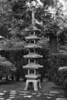 This antique five-tiered pagoda lantern was given to city of Portland in 1963 by Sapporo, our Sister City in Japan.  The stones at the base of the pagoda symbolize the island of Hokkaido. One of the stones is red stone symbolize Sapporo as the capital.  Japanese Garden, Portland Oregon