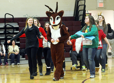 WARREN DILLAWAY / Star Beacon THE SOPHOMORE Pymatuning Vallety Reindeer Games dance gets started with (from left front) Katie Stokes, Austin Limestoll (Rudolph) and Sophia Hochran leading     the way on Friday afternoon in Andover Township.