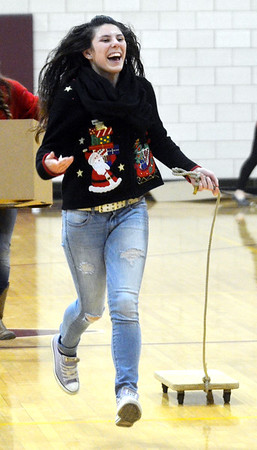 WARREN DILLAWAY / Star Beacon KAITLYN MARSH competes in a relay race during Reindeer Games at Pymatuning Valley HIgh School on Friday afternoon.