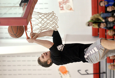 WARREN DILLAWAY / Star Beacon SAM CASKEY competes in the slam dunk competition during the Reindeer Games at Jefferson High School on Friday.