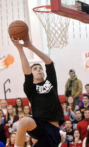 WARREN DILLAWAY / Star Beacon BLAKE PERRY competes in the slam dunk competition during the Reindeer Games at Jefferson High School on Friday.